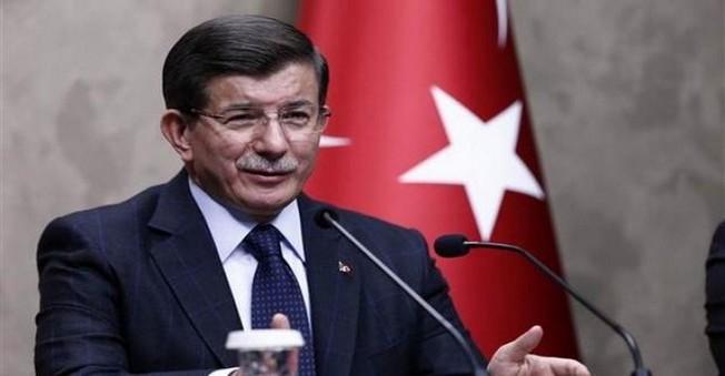 Davutoğlu: Rus pilotun cenazesi Türkiye'ye teslim edildi